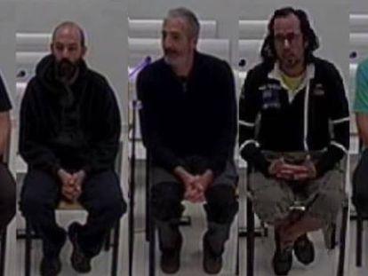 Desde la izquierda, Buigas, Jolis, Tomàs, Codina, Ros, Duch y Garzón, durante sus declaraciones ante el juez de la Audiencia Nacional.