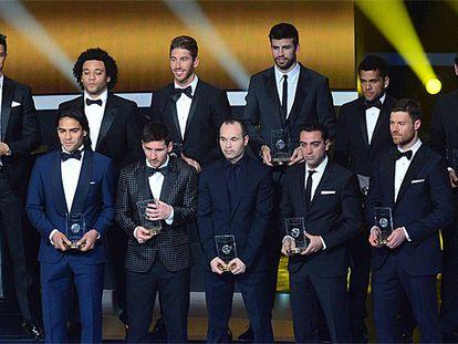 De izquierda a derecha, y de arriba abajo, Cristiano, Marcelo, Sergio Ramos, Piqué, Alves, Casillas; Falcao, Messi, Iniesta, Xavi y Xabi Alonso. / AFP
