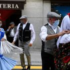 """Two couples dressed up in the Madrid traditional """"chulapa"""" and """"chulapo"""" costumes dance to the sound of a barrel organ on May 15, 2021 during the town's local holiday of """"San Isidro"""" that honours Madrid's patron Saint Isidore the Labourer. (Photo by GABRIEL BOUYS / AFP)"""