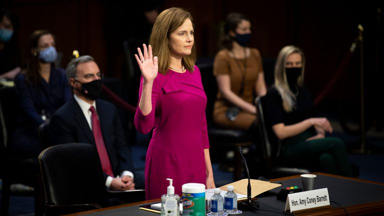 Supreme Court nominee Amy Coney Barrett is sworn in during a confirmation hearing before the Senate Judiciary Committee, Monday, Oct. 12, 2020, on Capitol Hill in Washington. (Caroline Brehman/Pool via AP)