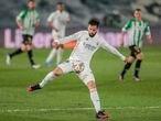 Real Madrid's Nacho controls the ball during the Spanish La Liga soccer match between Real Madrid and Betis at the Alfredo di Stefano stadium in Madrid, Spain, Saturday, April 24, 2021. (AP Photo/Bernat Armangue)
