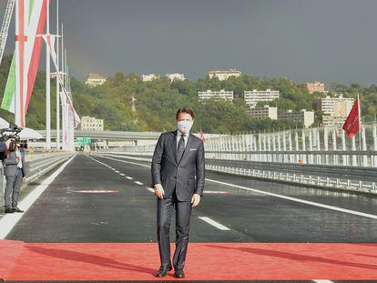 Italian Premier Giuseppe Conte walks along the new San Giorgio Bridge in Genoa, Italy, Monday, Aug. 3, 2020. Two years ago this month, a stretch of roadbed collapsed on Genoa's Morandi Bridge, sending cars and trucks plunging to dry riverbed below and ending 43 lives. On Monday, Italy's president journeys to Genoa for a ceremony to inaugurate a replacement bridge. Designing the new span was Genoa native, Renzo Piano, a renowned architect.(Gian Mattia D'Alberto/LaPresse via AP)