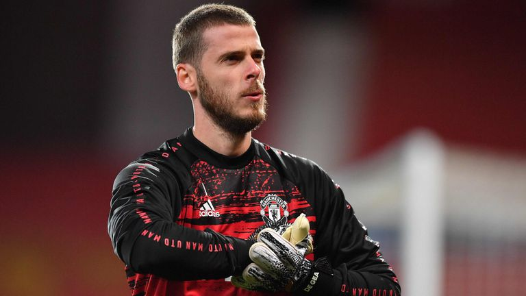 Manchester United's Spanish goalkeeper David de Gea warms up ahead of the UEFA Champions league group H football match between Manchester United and RB Leipzig at Old Trafford stadium in Manchester, north west England, on October 28, 2020. (Photo by Anthony Devlin / AFP)