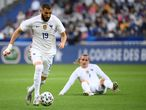 France's forward Karim Benzema (L) drives the ball during the friendly football match France vs Bulgaria ahead of the Euro 2020 tournament, at Stade De France in Saint-Denis, on the outskirts of Paris on June 8, 2021. (Photo by FRANCK FIFE / AFP)