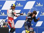 Winner Ducati-Pramac Spanish rider Jorge Martin (L) and third placed Yamaha French rider Fabio Quartararo celebrate on the podium after the Styrian Motorcycle Grand Prix at the Red Bull Ring race track in Spielberg, Austria on August 8, 2021. (Photo by Joe Klamar / AFP)