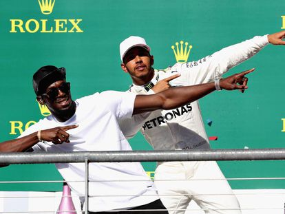 Usain Bolt y Hamilton, en el podio.