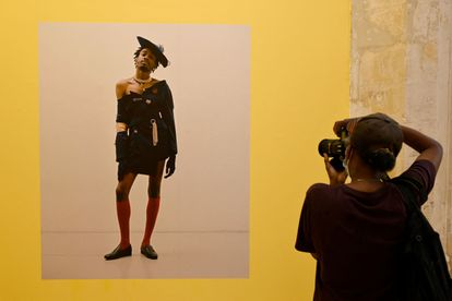 A photograph of Campbell Addy in the exhibition 'The New Black Vanguard', dedicated to the fashion photography of black artists, in Arles.