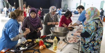 Encuentro de convivencia entre familias de refugiados sirios y familias de voluntarios de La Caixa en Madrid.