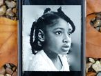 (FILES) In this file photo taken on November 30, 2020 A photograph taken in London on November 30, 2020 shows a mobile phone displaying a photograph of Ella Adoo-Kissi-Debrah who died died in February 2013 from a severe asthma attack. - A British legal first was made on December 16 when a coroner ruled that air pollution contributed to the death of a nine-year-old girl with severe asthma who lived by a busy road. Ella Adoo-Kissi-Debrah died in February 2013 after a serious asthma attack. In the previous three years, she had been taken to hospital nearly 30 times with breathing difficulties. The young girl lived in southeast London just 30 metres (yards) from a major ringroad in the capital which is often clogged with heavy traffic. (Photo by Hollie Adams / AFP)
