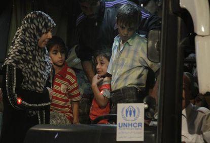 Refugiados sirios llegan al campo de Zaatari, en Jordania.