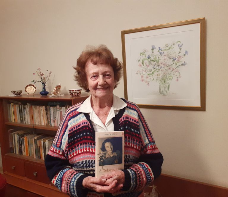 Dita Kraus, at her home in Netanya (Israel), with a copy of her autobiography, published in English by Penguin.