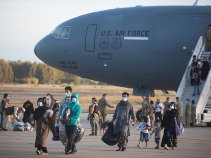 Evacuees from Afghanistan disembark from a U.S. airforce plane at the Naval Station in Rota, southern Spain, Tuesday Aug 31, 2021. The United States completed its withdrawal from Afghanistan late Monday, ending America's longest war.(AP Photo/ Marcos Moreno)