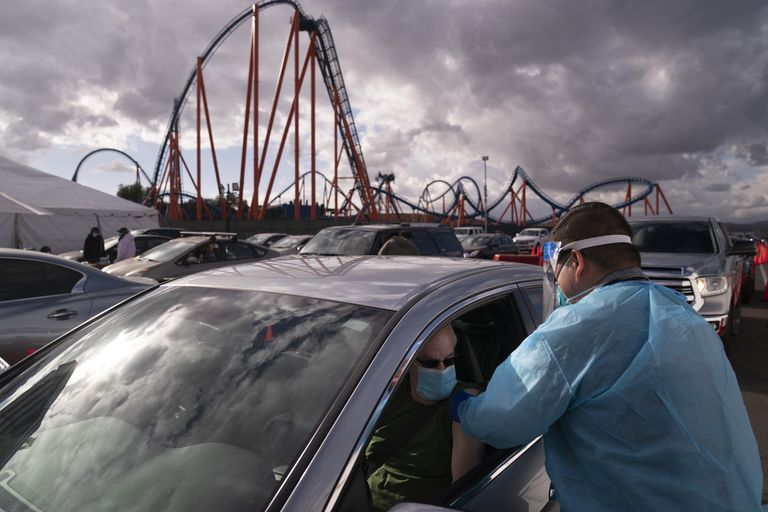 A man gets the vaccine in the parking lot of Six Flags, California, in January 2021.