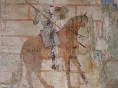 Pintura que representa a san Jorge, con armadura, lanza y montura, en la ermita gótica de Ruesga (Cantabria).