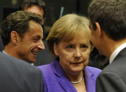 Sarkozy, Merkel y Zapatero, a su llegada a la Cumbre del Consejo Europeo.
