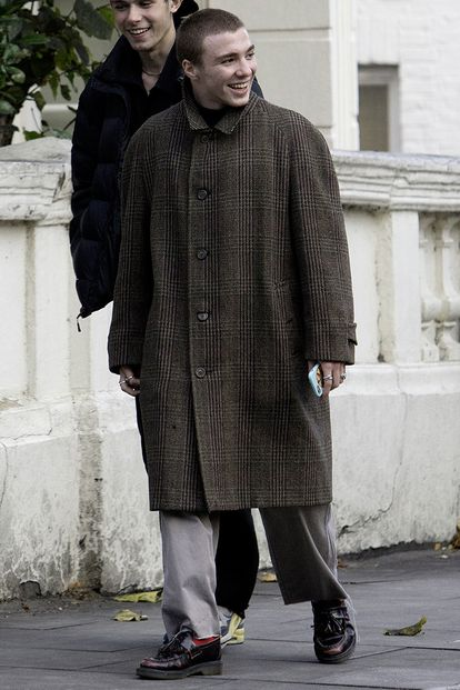 Rocco Ritchie walking around London in 2017. He wears a coat that could easily have come out of the wardrobe of 'Sherlock Holmes' the movie his father directed.