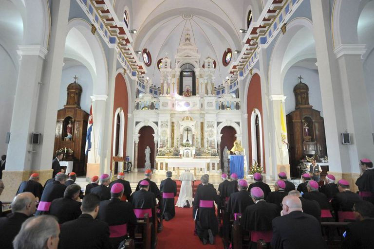 Benedict XVI prays in a church in Santiago de Cuba last year.