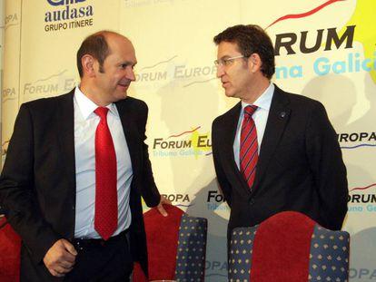 Louzán y Feijóo, durante un desayuno informativo en 2013.