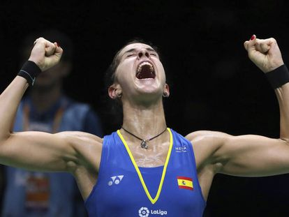 Carolina Marin of Spain reacts after beating Pusarla V. Sindhu of India in their women's badminton championship match at the BWF World Championships in Nanjing, China, Sunday, Aug. 5, 2018. (AP Photo/Mark Schiefelbein)