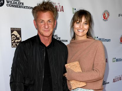 """LOS ANGELES, CALIFORNIA - MARCH 08: Sean Penn (L) and Leila George arrive at the """"Meet Me In Australia"""" event benefiting Australia Wildfire Relief Efforts at Los Angeles Zoo on March 08, 2020 in Los Angeles, California.   Kevin Winter/Getty Images/AFP == FOR NEWSPAPERS, INTERNET, TELCOS & TELEVISION USE ONLY =="""
