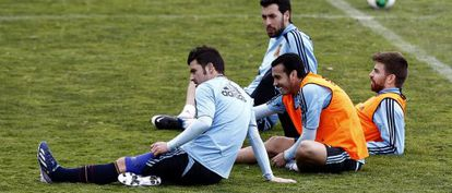 Villa, Pedro, Busquets y Piqué, en un entrenamiento
