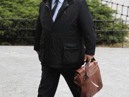 Adolfo Carretero, a su llegada a los juzgados de Plaza Castilla, en 2013