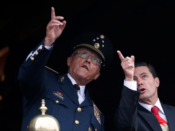 Mexico's President Enrique Pena Nieto and Defense Minister General Salvador Cienfuegos gesture during a military parade to celebrate Independence Day at Zocalo Square in Mexico City, Mexico September 16, 2018. REUTERS/Gustavo Graf