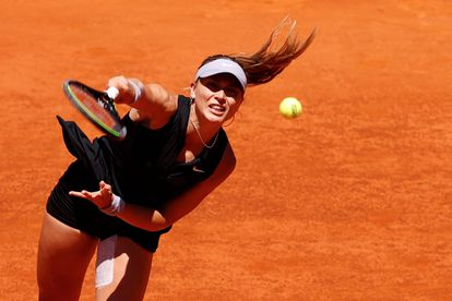 Badosa serves during the match against Barty in Madrid.