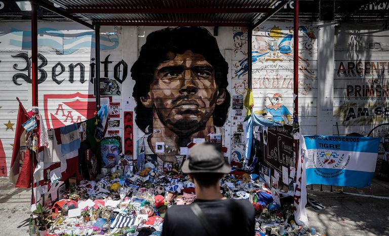 A Maradona mural turned into a sanctuary at the Argentinos Juniors Stadium in Buenos Aires (Argentina).