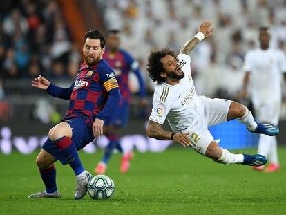 Marcelo cae ante Messi en el último clásico en el Bernabéu.