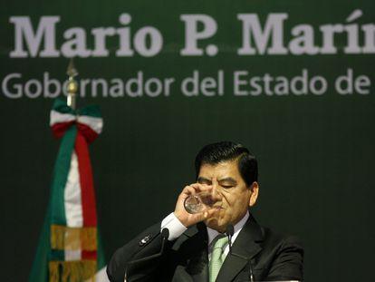 Mario Marín, durante una conferencia cuando era gobernador de Puebla.