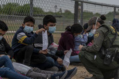 Unaccompanied minors are registered by Border Patrol agents in the community of La Joya, Texas.