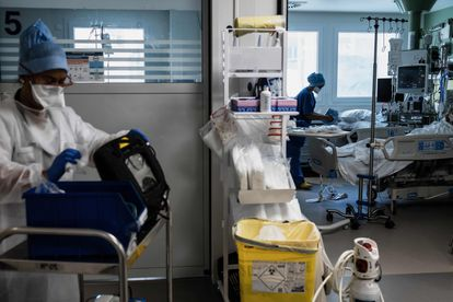 Nurses work in the Covid-19 intensive care unit of Lyon-Sud hospital in Pierre-Benite, central eastern France on September 8, 2021. (Photo by JEFF PACHOUD / AFP)