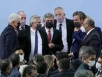 Argentina's President Alberto Fernandez (3-L) gestures after taking oath to Agriculture, Livestock and Fisheries new Minister Julian Dominguez (L), Communication and Press new Secretary Juan Ross (2-L), Science and Technology new Minister Daniel Filmus (C), Education new Minister Jaime Perzyck (3-R), Foreign new Minister Santiago Cafiero (2-R) and new Chief Cabinet Juan Manzur (R) at the Casa Rosada in Buenos Aires, on September 20, 2021. - Argentine President Alberto Fernandez put his new ministers in office on Monday to relaunch the government in an attempt to get back in the race towards the legislative elections in November and save his coalition of center-left Peronists. (Photo by NATACHA PISARENKO / POOL / AFP)