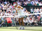 02 July 2021, United Kingdom, London: Spanish tennis player Garbine Muguruza reacts as she almost goes over the net whilst in action against Tunisia's Ons Jabeur during their women's singles third round match on day five of the 2021 Wimbledon Tennis Championships at The All England Lawn Tennis and Croquet Club. Photo: Adam Davy/PA Wire/dpa 02/07/2021 ONLY FOR USE IN SPAIN