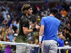 Greece's Stefanos Tsitsipas (L) shakes hands with Britain's Andy Murray after winning their 2021 US Open Tennis tournament men's singles first round match at the USTA Billie Jean King National Tennis Center in New York, on August 30, 2021. (Photo by TIMOTHY A. CLARY / AFP)