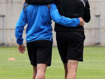 Aguirre y Torje en el entrenamiento de ayer.