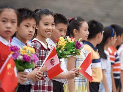 Niños chinos en una ceremonia oficial en el Gran Salón del Pueblo (Pekín), el 13 de septiembre.