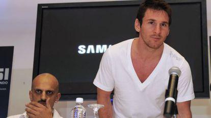 Messi (derecha), junto a Guillermo Marín, en julio de 2013 en Panamá.