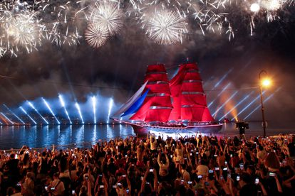 Hundreds of spectators watch the fireworks of the Scarlet Candles festival, which is celebrated in honor of high school graduates in St. Petersburg, last Saturday.