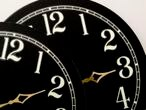 Two clock faces showing hours to adjust your clocks for Daylight Savings time.