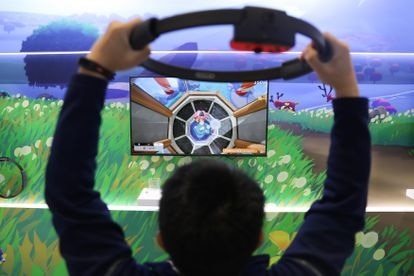 A user plays Ring Fit Adventure, Nintendo's active video game focused on physical exercise