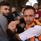 Palestinian medics evacuate a wounded protester amid clashes with Israeli security forces in Jerusalem's Old City on May 10, 2021, as a planned march marking Israel's 1967 takeover of the holy city threatened to further inflame tensions. (Photo by EMMANUEL DUNAND / AFP)