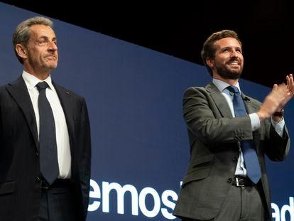 Nicolas Sarkozy (izquierda) junto a Pablo Casado, durante la convención del PP, en Madrid este miércoles.
