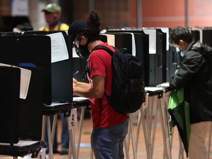 Algunos votantes en Miami (Florida), este miércoles.