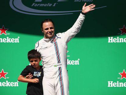 Massa, con su hijo, tras el GP de Brasil.
