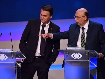 Los candidatos Jair Bolsonaro y Henrique Meirelles en un debate electoral el pasado jueves