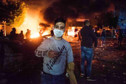 Abdalá Jarah, de 20 años, durante una manifestación el pasado mes de diciembre en el barrio marginal de Tariq al Yadid, en Beirut.