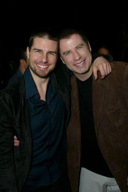 Tom Cruise y John Travolta, durante un cumpleaños de este último.