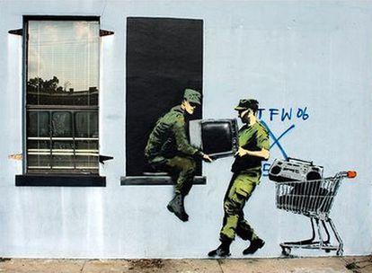 Uno de los <i>graffitis</i> de Banksy en Nueva Orleans.
